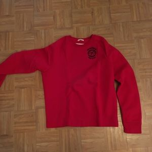 Red crewneck with embroidered logo on front